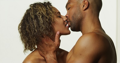 Man and woman kissing; resuming intimacy after plastic surgery