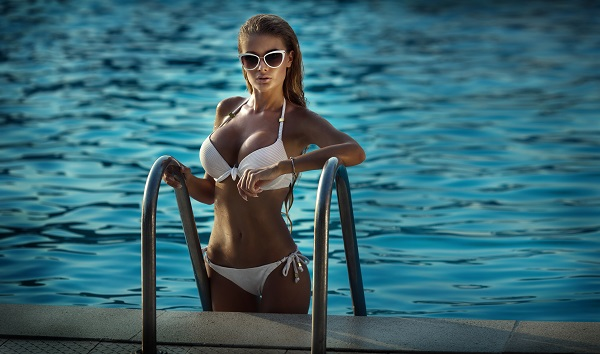 Woman swimming in a pool near Las Vegas after breast augmentation
