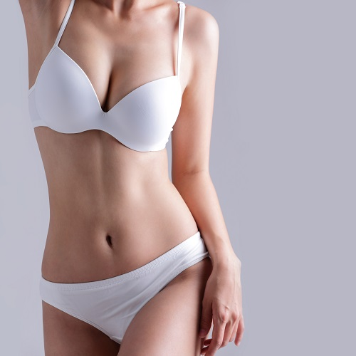 Woman with tighter body contour following liposuction in Las Vegas