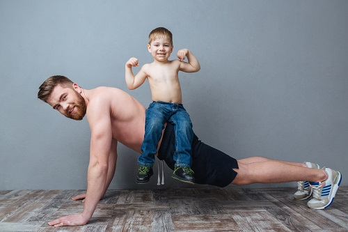 Father with dad bod working out before liposuction sculpting-